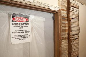 Clearly label asbestos-containing materials on site
