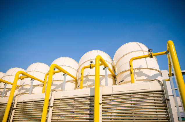 Sets of cooling towers in conditioning systems at office building.
